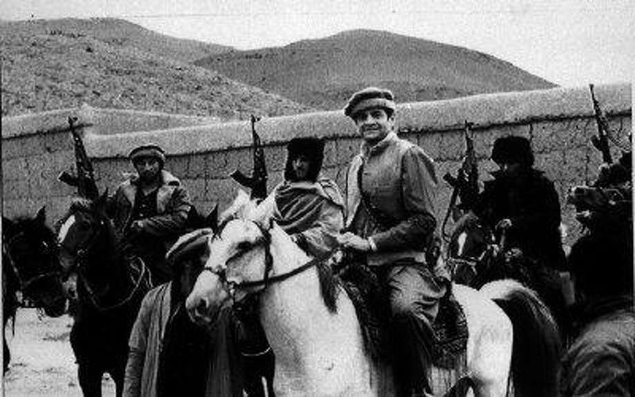 This July 1987 file photo shows Rep. Charlie Wilson, D-Texas, on a white horse while in Afghanistan. / AP2010