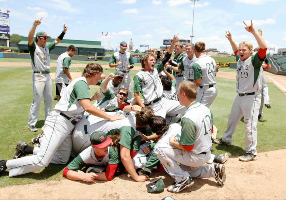 The Woodlands players celebrate after defeating Fort Bend Dulles 9-5 to win the Class 5A UIL state baseball championship game on Saturday. Go to HCNPics.com to view and purchase this photo, and others like it. Photo: Staff Photo By Jason Fochtman
