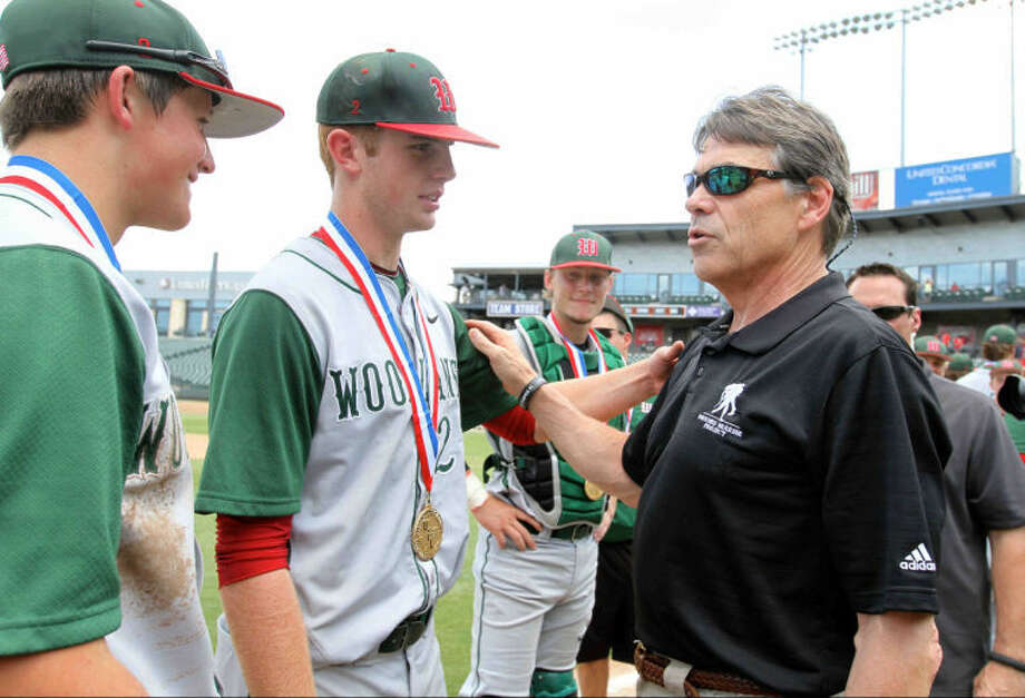 The Woodlands pitcher Carter Hope (23) greets Texas Governor Rick Perry after winning the Class 5A UIL state baseball championship game on Saturday. Photo: Staff Photo By Jason Fochtman
