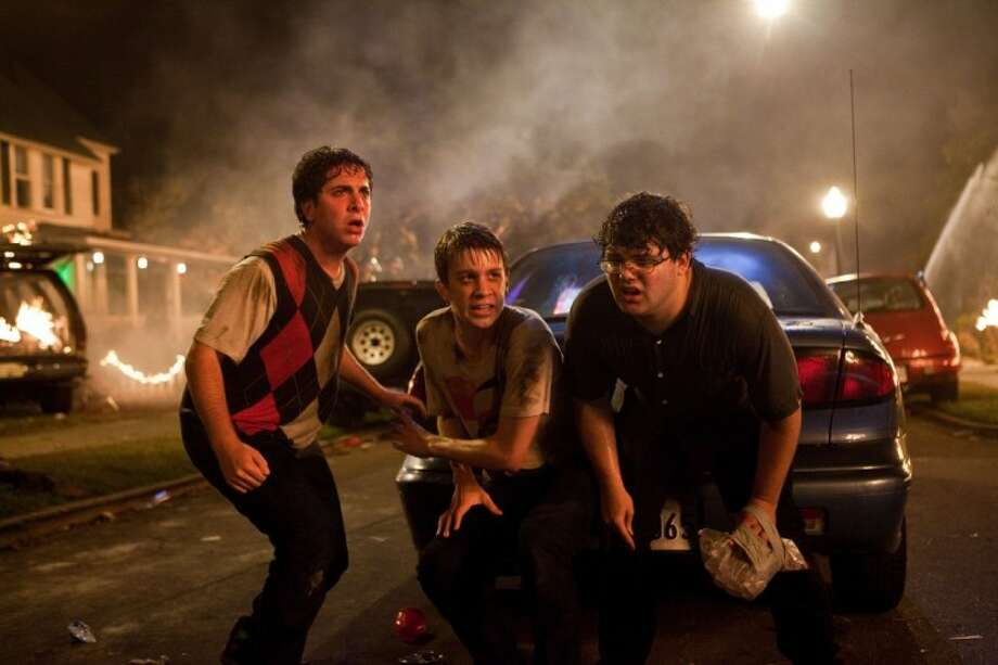 "In this film image released by Warner Bros., from left, Oliver Cooper, Thomas Mann, and Jonathan Daniel Brown are shown in a scene from ""Project X."" Photo: Beth Dubber"