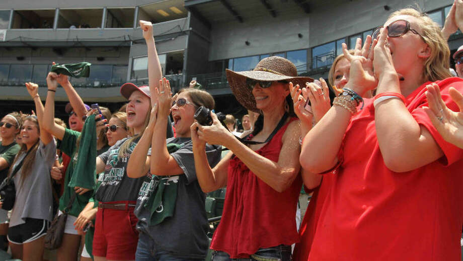 The Woodlands fans cheer after the Class 5A UIL state baseball championship game on Saturday, June 8, 2013, at Dell Diamond in Round Rock, Texas. The Woodlands defeated Fort Bend Dulles 9-5. Go to HCNPics.com to view and purchase this photo, and others like it. Photo: Staff Photo By Jason Fochtman