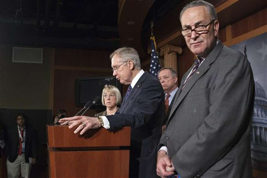 Senate Majority Leader Harry Reid of Nev., second from left, accompanied by fellow Senate Democratic leaders, speaks during a news conference on Capitol Hill in Washington, Thursday, March 8, 2012, to talk about roadblocks on passing the highway bill. From left are, Sen. Patty Murray, D-Wash., Reid, Senate Majority Whip Richard Durbin of Ill., and Sen. Charles Schumer, D-N.Y. (AP Photo/J. Scott Applewhite) Photo: Photo By J. Scott Applewhite / AP