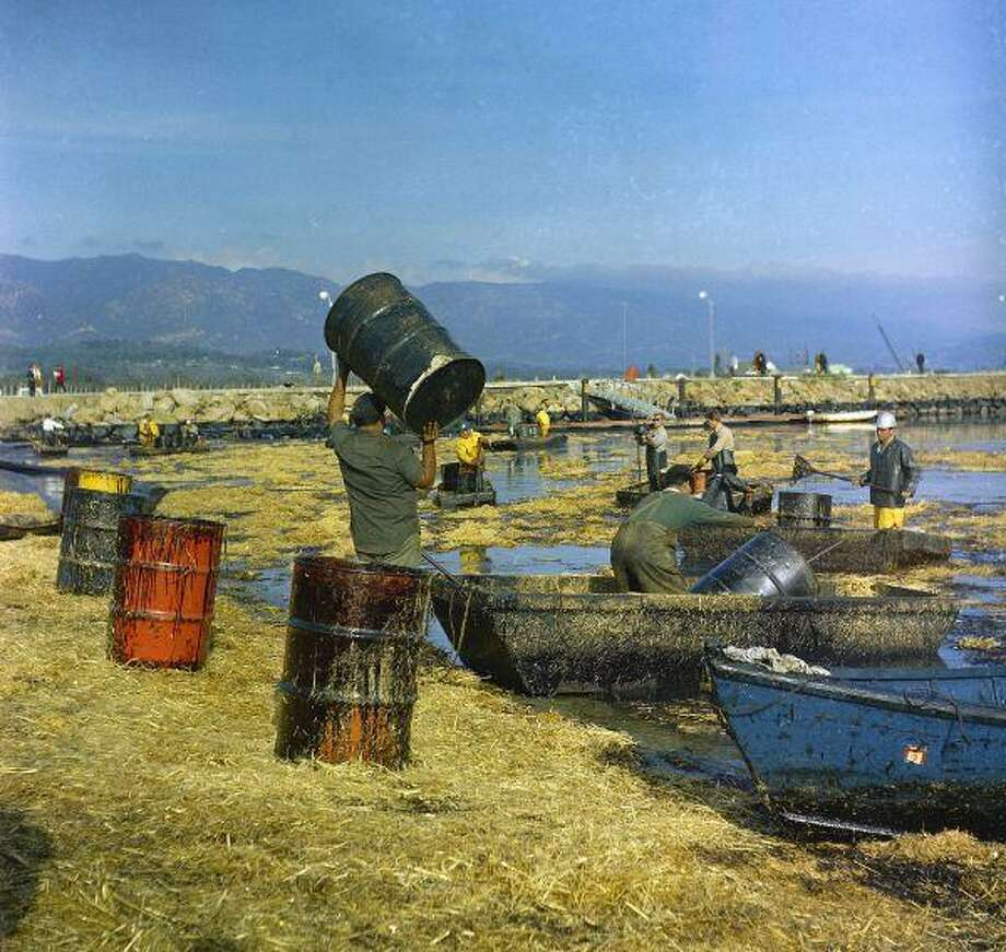 In this 1969 file photo, workmen using pitchforks, rakes and shovels attempt to clean up oil-soaked straw from the beach at Santa Barbara Harbor, Calif. The straw was used to absorb oil from a week-long leak from an offshore well that covered local beaches and threatened many others on the southern California shoreline areas. Forty years later,, lawmakers begin hearings on an energy and global warming bill that could revolutionize how the country produces and uses energy. / AP