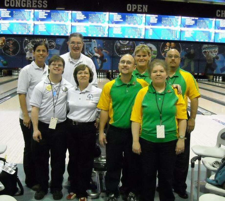 A Bridgewood Farms bowling team, left, stands next to a team from Ohio during the 2009 Unified Sports National Bowling Tournament, a part of Special Olympics.