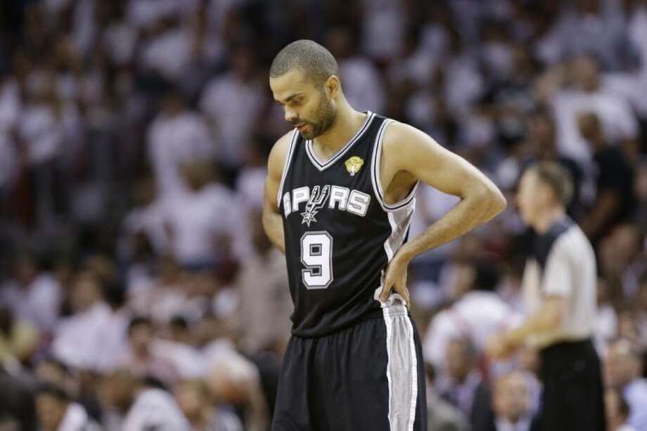 San Antonio Spurs guard Tony Parker looks down as his team drops a 103-84 decision to the Miami Heat. Photo: Lynne Sladky