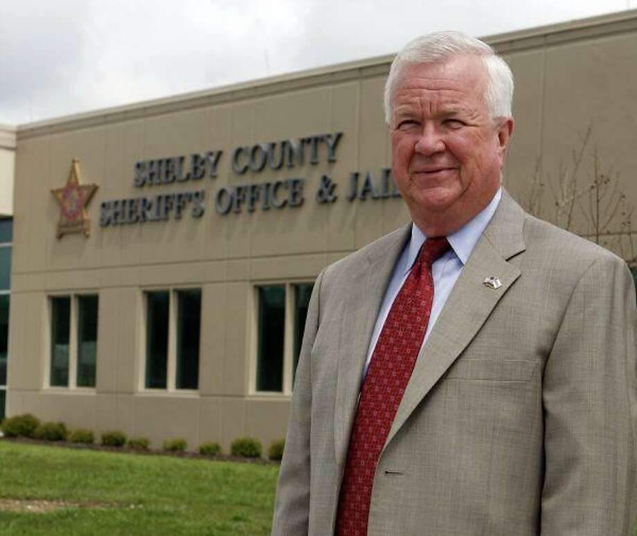 Shelby County Sheriff Chris Curry stands in front of the Sheriff's Office in Columbiana, Ala. Curry found out firsthand last Aug. 20 that the drug war, and the savagery it brings, had landed in his back yard with the brutal killing of five men at an apartment complex in Alabama's wealthiest county. / FR111446 AP