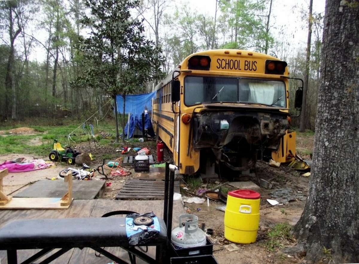 An 11-year-old girl and her 5-year-old brother were found to be living in this broken down bus on a dirt road in Splendora. The children's father was sentenced to 18 months in prison for conspiracy in January, and their mother received the same sentence in February. They were living in the bus with their great-aunt.