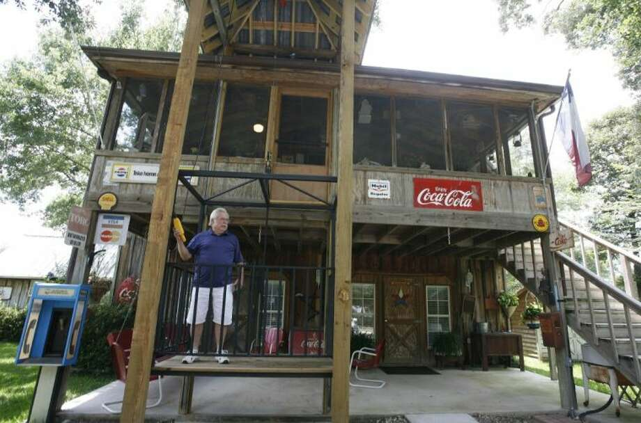 David Johnston rides the mechanical lift at the home he built on Country Lane in Shenandoah.