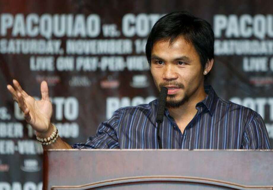 File - In this Nov. 11, 2009, file photo, Manny Pacquiao, of the Philippines, speaks during a news conference at the MGM Grand in Las Vegas. Floyd Mayweather Jr. blamed Pacquiao for the collapse of their prospective bout Thursday, Jan. 7, 2010, claiming the Filipino boxer refuses to accept a reasonable compromise on drug testing concerns. (AP Photo/Isaac Brekken,file) / AP2009