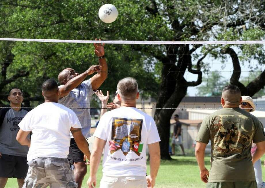 In this photo taken May 31, 2013, Sgt. 1st Class Corey Edwards, Bravo Company, 1st Battalion, Warrior Transition Brigade, Fort Hood, Texas, attempts a kill at the net during a volleyball game as part of a Fort Hood Adaptive Reconstruction event at Fort Hood's Sportsmen's Center Pavilion. Photo: TJ MAXWELL