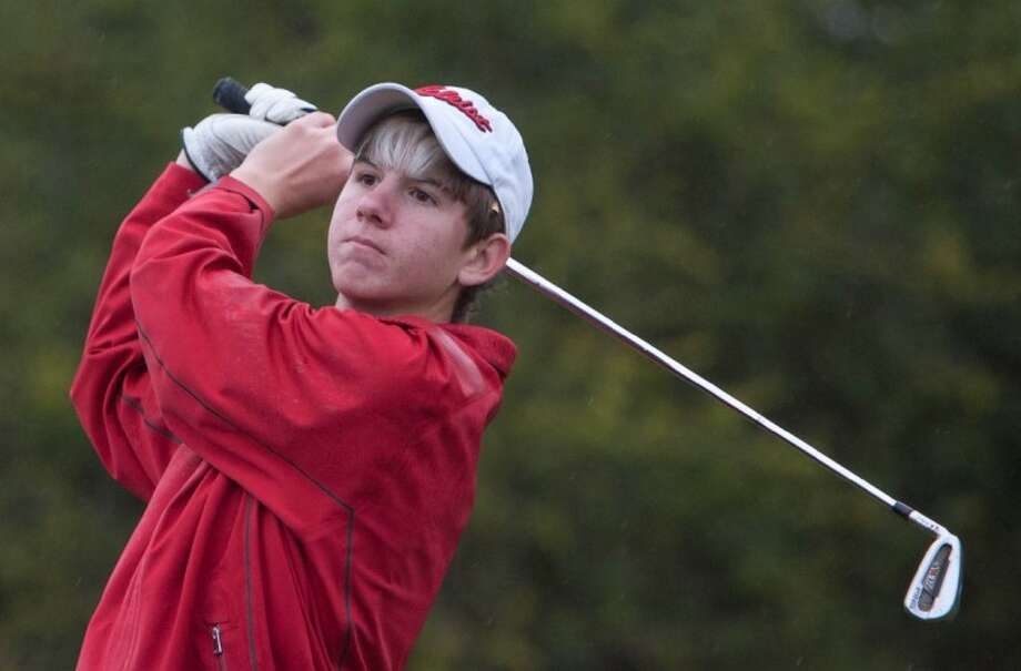 The Woodlands' Collins Lenfant follows through on his shot from the first tee during Friday's Montgomery Bear Tournament at the April Sound Country Club in Conroe. Photo: Staff Photo By Eric S. Swist