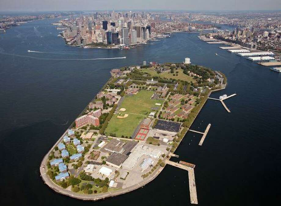 This Sept. 8, 2008, file aerial photo shows Governors Island in New York harbor, with lower Manhattan in the background center. Manhattan community activists are pushing a host of alternative locales for the trial of admitted 9/11 mastermind Khalid Sheikh Mohammed and four terror suspects in a bid to keep the spectacle out of their neighborhood. The suggestions include Governors Island, an air base in Newburgh and an old prison in upstate New York. / AP2008