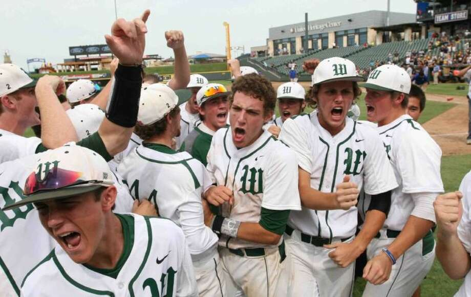The Woodlands players celebrate after Kolbi Brown's walk-off home run in the bottom of the seventh inning during a Class 5A UIL state baseball semifinal game in Round Rock. The Woodlands defeated Northside O'Connor 2-1. Go to HCNPics.com to view and purchase this photo, and others like it. Photo: Staff Photo By Jason Fochtman