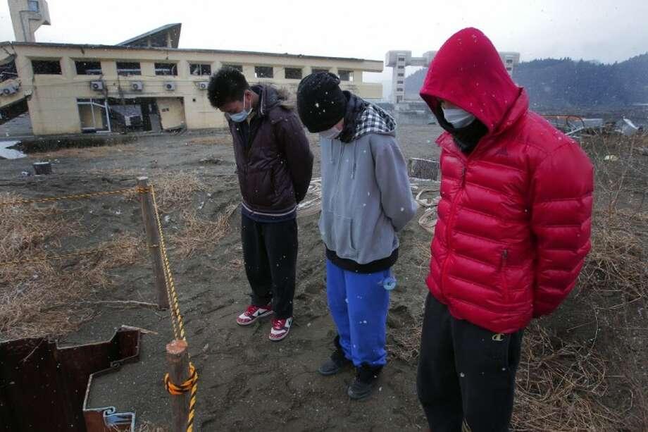 High school students mourn the victims of the March 11, 2011 earthquake and tsunami, in Rikuzentakata, Iwate Prefecture, northeastern Japan, Sunday. Photo: Itsuo Inouye