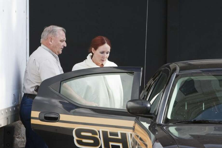 Shannon Richardson is placed into a Titus County Sheriff's car after an initial appearance Friday at the federal building Texarkana. The FBI says Richardson admitted sending ricin-tainted letters to President Barack Obama and New York City Mayor Michael Bloomberg, but only after trying to pin it on her husband. Photo: Curt Youngblood
