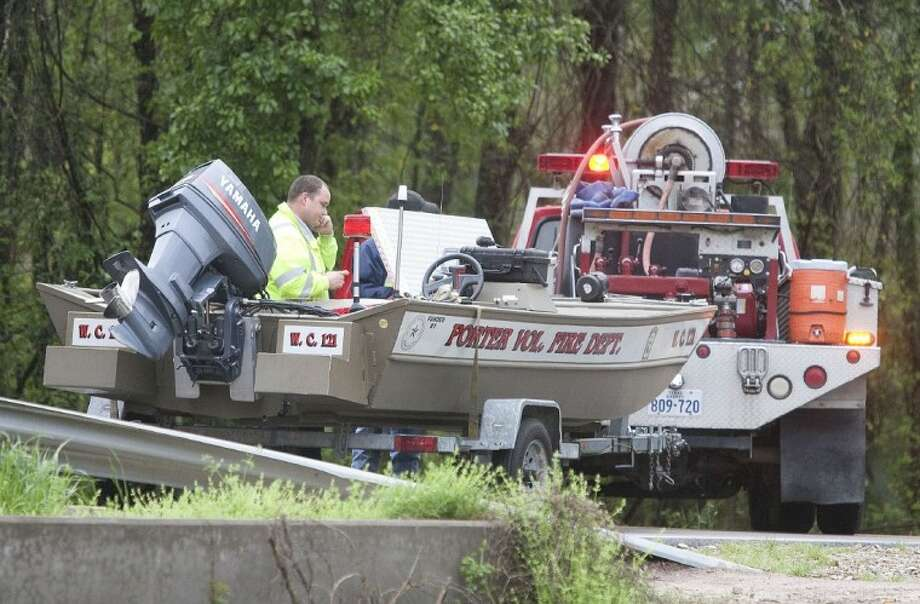 Emergency crews look for two missing children in a drainage canal intersecting Sorters Road in Porter on Sunday. The boys were able to safely get to shore. Photo: Karl Anderson