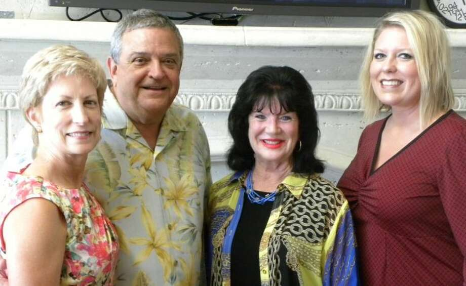 Hosts Karen and Ray Solcher, Montgomery County Crime Stoppers Board Member Dawn Cleboski and Montgomery County Sheriff's Deputy/Crimer Stoppers Unit Brandy Collins pose for a picture at Thursday's wine and cheese reception.