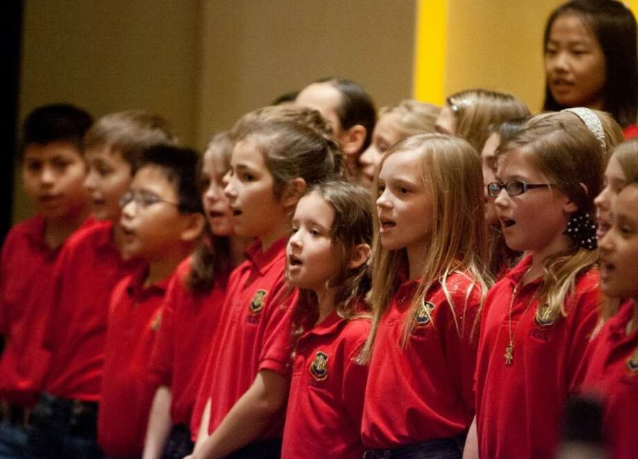 Members of the Sally K. Ride fourth-grade choir perform for attendees during the Eighth Annual Interfaith Five Who Share Luncheon on Friday at The Woodlands Waterway Marriott. Photo: Staff Photo By Eric S. Swist