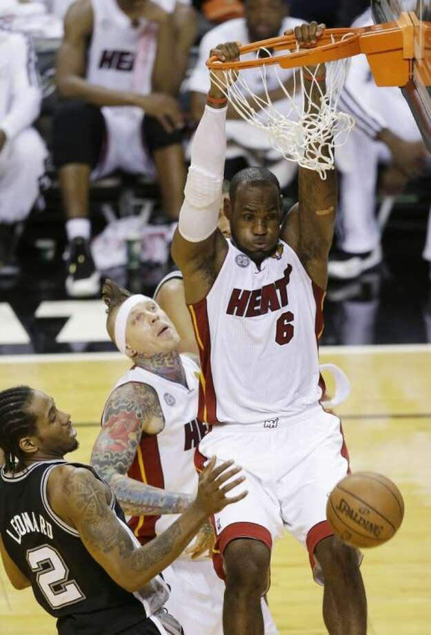 Miami Heat forward LeBron James dunks the ball during the second half of Game 6 of the NBA Finals against the San Antonio Spurs on Tuesday in Miami. Photo: Wilfredo Lee