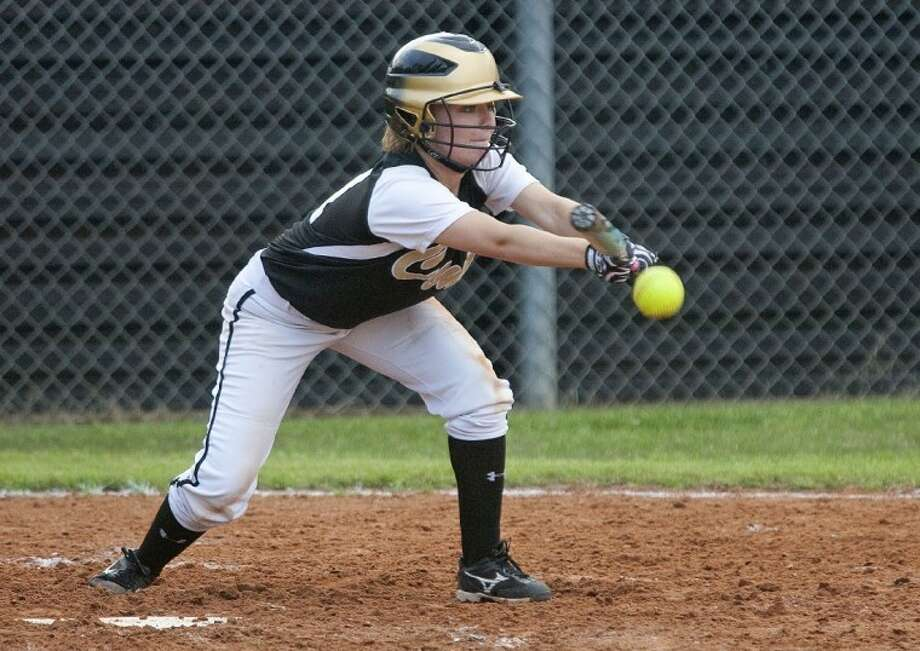 Conroe's Shelby Davis bunts during the game against College Park Tuesday at Conroe High School. Photo: Karl Anderson