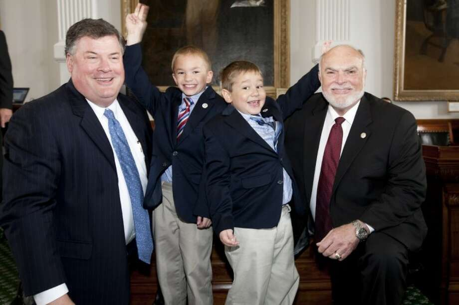 Brothers Gabriel Thomas McDowell and Drew Christian McDowell, of Magnolia, have fun with state senators Tommy Williams of The Woodlands, left, and Robert Nichols of Jacksonville, who both represent Montgomery County. The boys were recognized Monday on the floor of the Texas Senate for their work in raising nearly $2,000 for cancer research by holding a contest to find the best cupcake in Texas.