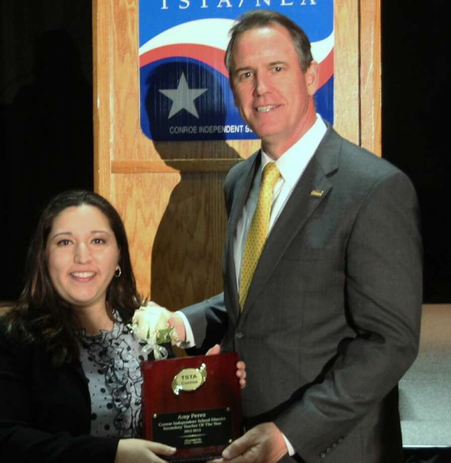 Amy Perez receives her award from CISD Superintendent Dr. Don Stockton.