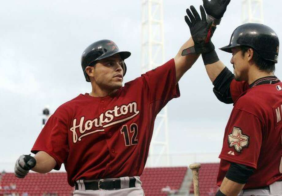 Houston catcher Ivan Rodriguez is congratulated by teammate Kazuo Matsui after hitting a home run off Cincinnati's Aaron Harang in the second inning Tuesday. / FR31154 AP