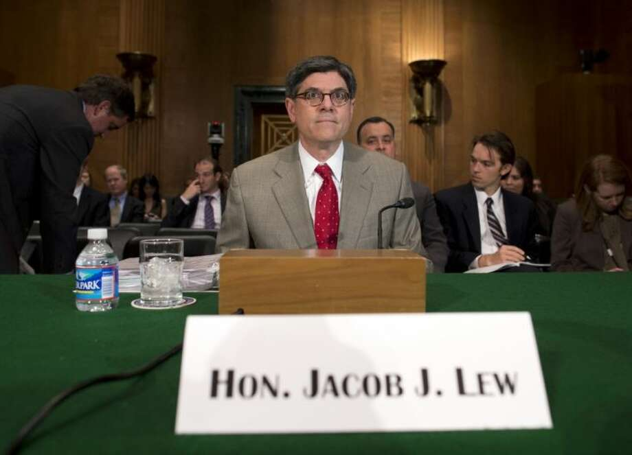 "Treasury Secretary Jacob Lew prepares to testify on Capitol Hill in Washington, Tuesday, before the Senate Banking Committee. Lew said the Internal Revenue Service's (IRS) targeting of conservative political groups was ""unacceptable and inexcusable"" and he has directed the agency's acting director to hold people accountable. Photo: Evan Vucci"