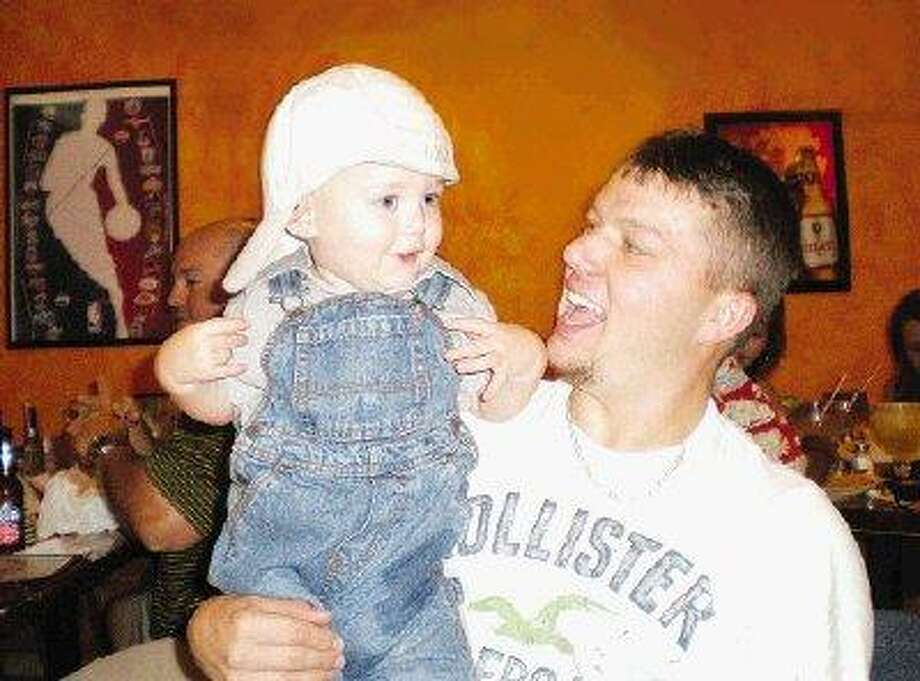 George Benjamin Macaluso II, right, holds his son Trey during a birthday celebration for Alesha Macaluso, the sister of George Benjamin Macaluso II. The celebration of her birthday was the last she got to share with her brother before he died March 28, 2008, Alesha Macaluso said.