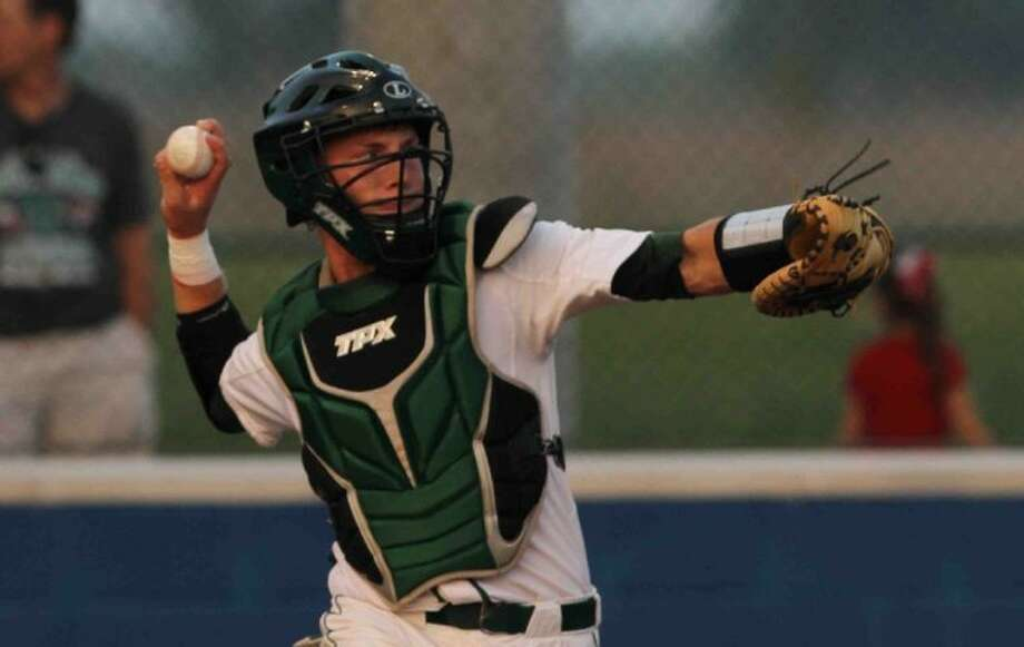 The Woodlands catcher Alex Dunlap is batting .562 with six RBI in five games this postseason. The Highlanders will face Plano West this weekend in the Region II-5A semifinals in Georgetown. Photo: Staff Photo By Jason Fochtman