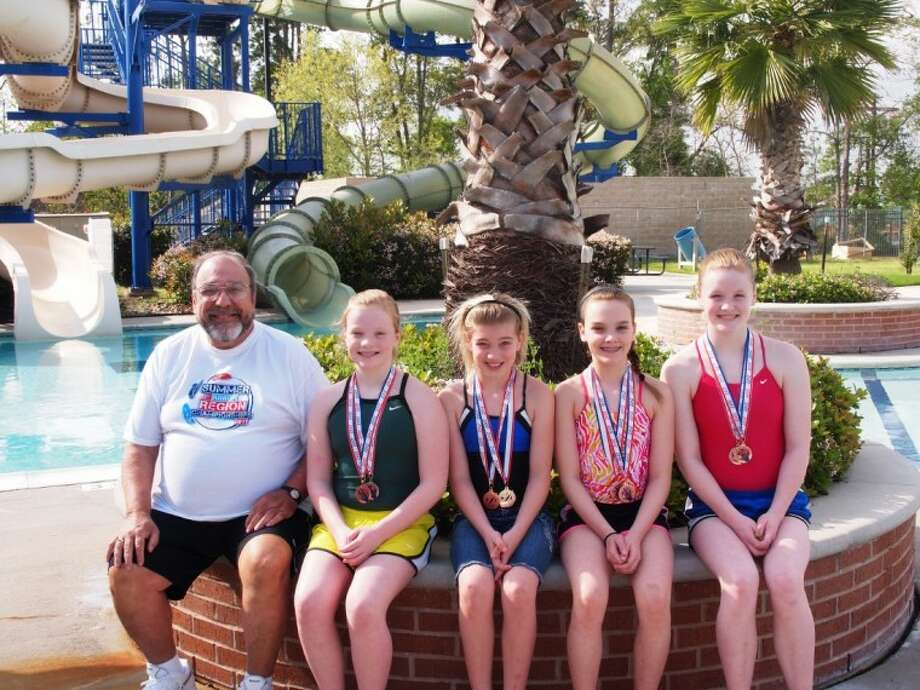 Three members of the Conroe Diving Club advanced to the 2012 Hilton Honors Junior West National Diving Championships recently. Pictured are coach Charlie Casuto, Abigail Andrews, Reagan Hinze, Michaela Dylag, and Claire Andrews.
