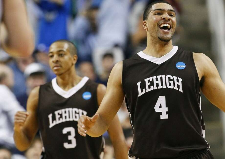 Lehigh's John Adams (4) and C.J. McCollum (3) celebrate after winning an NCAA tournament second-round college basketball game against Duke in Greensboro, N.C., Friday. Lehigh won 75-70. Photo: Gerry Broome