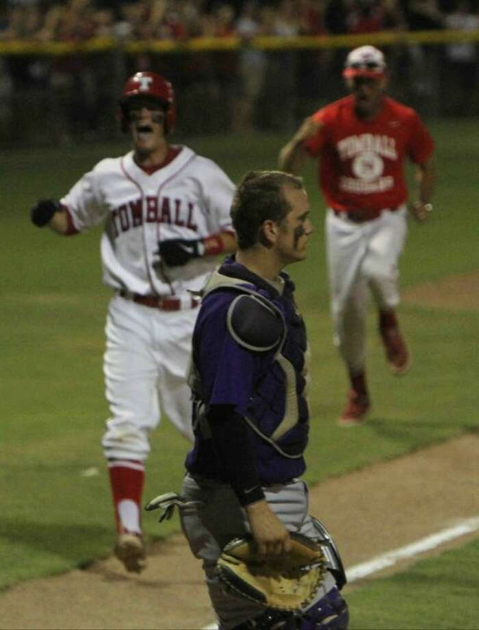 Montgomery catcher Cody Conn walks off the field as Tomball's Eric Dunbar comes in to score on Ishmael Edwards' three-run walk-off home run on Thursday at Tomball High School. To view or purchase this photo and others like it, visit HCNpics.com. Photo: Staff Photo By Jason Fochtman
