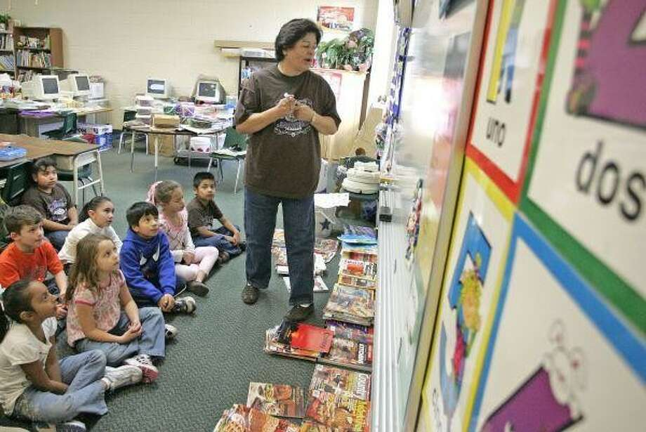 In this Jan. 16, 2009, file photo, first-grade teacher Ann Chapa teaches students at Edward B. Cannan Elementary in Willis. The students were part of the Hand in Hand dual-language program, started by Willis Independent School District in August 2007. Photo: Eric S. Swist / Staff