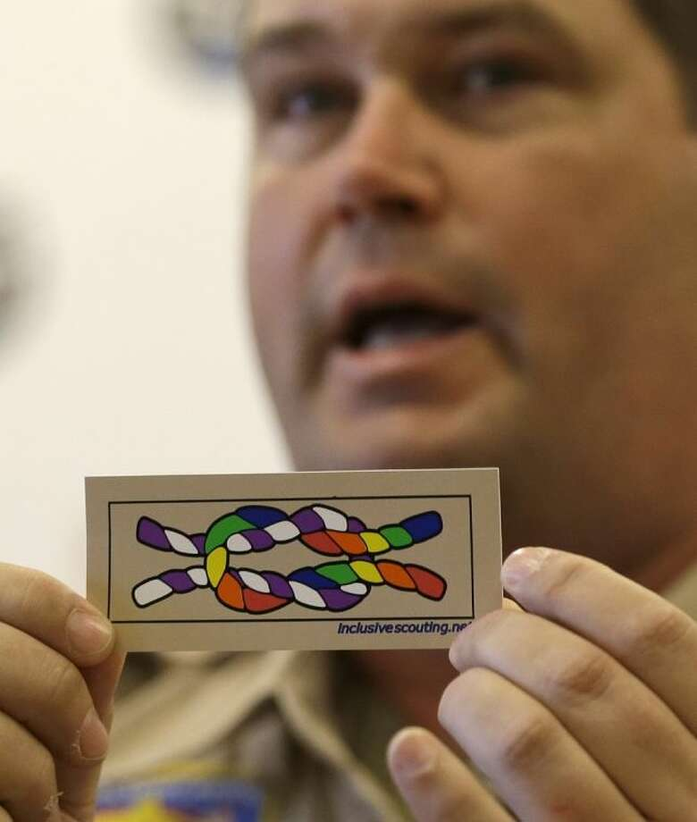 Former Scout Master Mark Noel, of Hanover, NH, holds up a new merit badge of inclusion during a press conference at the Equal Scouting Summit being held near where the Boy Scouts of America were holding their annual meeting Wednesday in Grapevine. Photo: LM Otero
