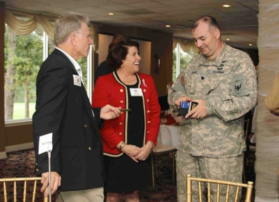 Ed Hale, left, and Julie Faubel joke with Lt. Col. Michael Odom during the Montgomery County Republican Women luncheon Thursday at River Plantation Country Club.