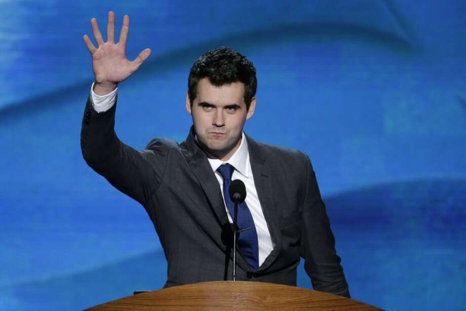 In this Sept. 6, 2012 file photo, Zach Wahls waves after addressing the Democratic National Convention in Charlotte, N.C. The Eagle Scout, a 21-year-old activist raised by lesbian mothers in Iowa, has been a leader of the campaign to end the BSA's no-gays policy. Photo: J. Scott Applewhite