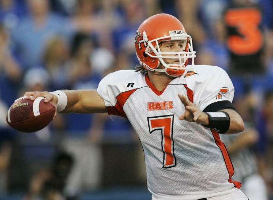 Former Sam Houston State quarterback Rhett Bomar was chosen in the fifth round by the New York Giants Sunday. Texas A&M's Stephen McGee went to Dallas, while Tech's Graham Harrall was not drafted. / AP
