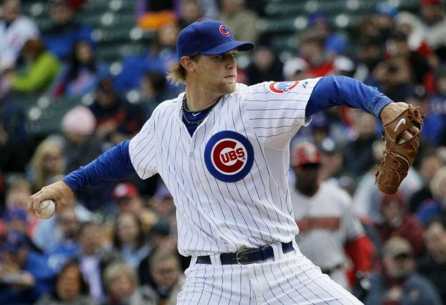 The Chicago Cubs' Andrew Cashner, a graduate of Conroe High School, delivers a pitch during the first inning of Tuesday's game against the Arizona Diamondbacks in Chicago.