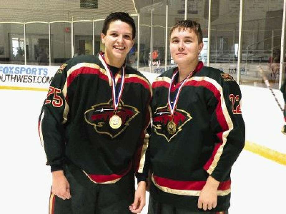 Evan Lonidier, left, and Levi Wurtz, both 16 and students at Montgomery High School, are part of the Houston Wild team that won the North Texas Hockey Leauge championships.