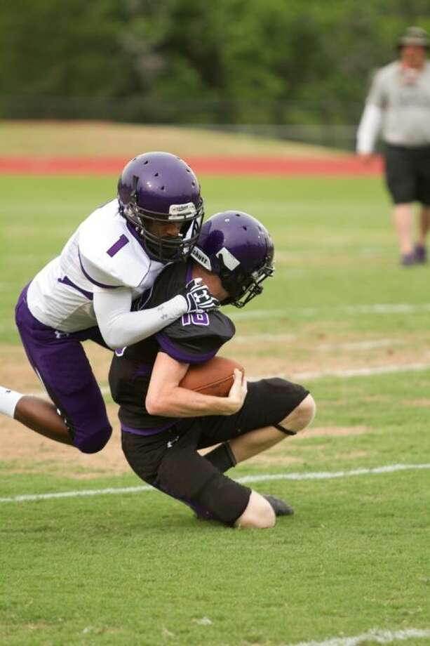 Willis' Morece Johnson tackles Dalton Jackson during the Wildkats' spring game on Friday. Photo: Billy Ballard