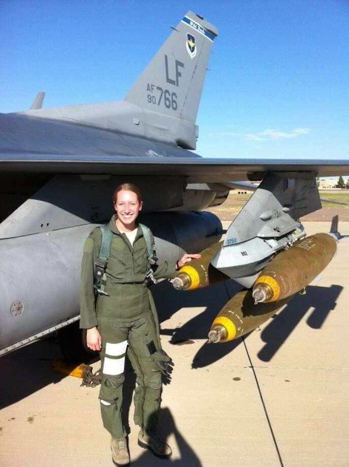 First Lt. Clancy Morrical poses next to her F-16 Fighting Falcon jet during her training at Luke AFB in Arizona. A 2006 graduate of Oak Ridge High School, Morrical is the only female fighter pilot at the Osan Air Base in South Korea.