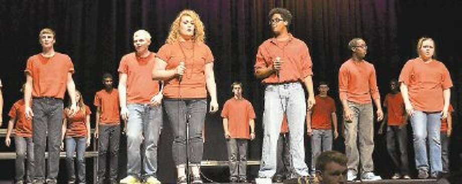 """Conroe High School Chorale Men and Women sing """"Some Nights,"""" by FUN, at Thursday night's Annual Choir Pop Show. In front, Rachael Sutton and Carl Marshall sing the duet together. / @WireImgId=2628879"""