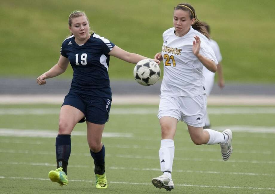 College Park's Hannah Rook and Conroe's Letty Barron chase the ball Saturday at Buddy Moorhead Memorial Stadium. See more photos online at www.yourhoustonnews.mycapture.com. Photo: Karl Anderson
