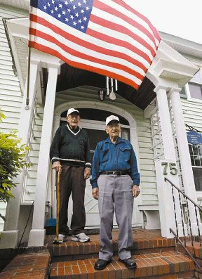 In this Wednesday, May 22, 2013 photo, World War II veterans Bob Addison, left, and Jerry West pose for a photo, in Glens Falls, N.Y. Addison and West share more than a longtime friendship. They share some of the same memories of bloody battles fought on Pacific islands while serving with an elite Marine Corps unit that was the forerunnner of today's U.S. Special Forces. Living just miles apart, the two men are among the last surviving members of the original Marine Raider battalions that were the first American ground troops to attack Japanese-held territory. Photo: Mike Groll / AP