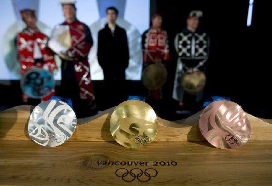 Photo: Jonathan Hayward / Canada Canadian B.C. British Columbia Vancouver Olympic Olympics medal medals OLY2010 gold silver  bronze