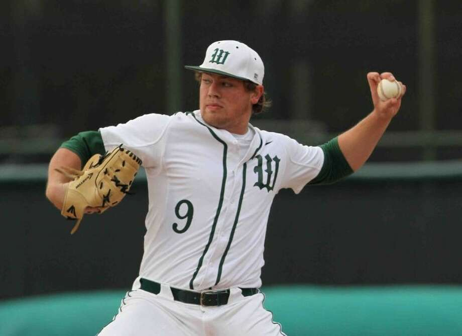 The Woodlands' Ryan Burnett pitches during a high school baseball playoff game against Atascocita earlier this season. The senior struck out eight in an 8-1 win over Plano West Friday night. Photo: Staff Photo By Jason Fochtman