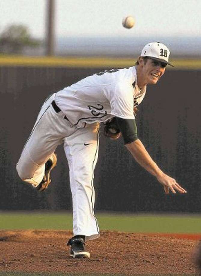 The Woodlands pitcher Carter Hope, pictured against Round Rock, helped lead his team to an 8-0 victory over Plano West on Saturday. The Highlanders swept the Region II-5A semifinal series. Photo: Staff Photo By Jason Fochtman / @WireImgId=2627862