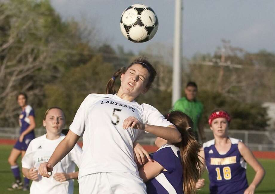 Willis' Jenny Corbett heads the ball during the game against Montgomery Monday at Berton A. Yates Stadium in Willis. Photo: Karl Anderson