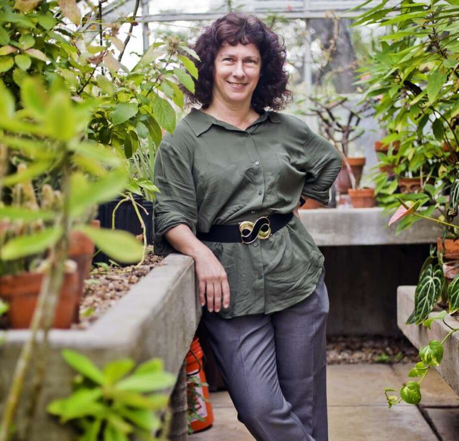 In this April 2 photo, University of Texas award-winning climatologist Camille Parmesan poses at the University of Texas' green house in Austin. Photo: Ricardo Brazziell